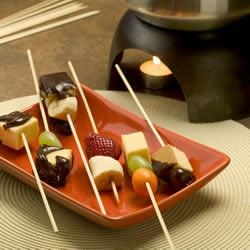 Totally Groovy Chocolate Fondue Recipe - Fondue made with milk chocolate, cream, cherry brandy, coffee and cinnamon.