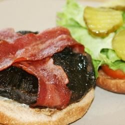Beth's Portobello Mushroom Burgers Recipe - Portobello mushroom caps are wrapped with turkey bacon, and cooked in a hot oven, then placed on buns with horseradish sauce, lettuce and tomato.