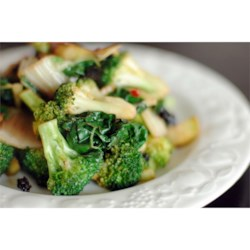 Stir-Fried Kale and Broccoli Florets Recipe - Kale and broccoli are stir-fried with slivered garlic and chopped chile peppers, and finished with a splash of lime juice for a bright-tasting, satisfying side dish.