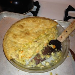 Grandma's Leftover Turkey Pot Pie Recipe - Bake an old-fashioned pot pie filled with turkey and vegetables in your trusty old cast-iron skillet.
