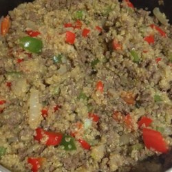 Dirty Quinoa with Venison Burger Recipe - Quinoa cooked with ground venison seasoned with blackened seasoning, veggies, and cayenne pepper is a spicy and lean twist on dirty rice and sausage.