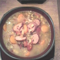 Slow Cooker Black-Eyed Pea and Sausage Soup Recipe - Dried black-eyed peas and sausage combine in this slow cooker soup with carrots, oregano, and garlic powder.