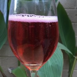 Red, White, and Bull Recipe - A sparkling champagne and energy drink cocktail.