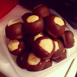 Buckeyes I Recipe - This recipe is so good that I double it whenever I make it. Since it is peanut butter balls dipped in chocolate it is almost like candy.  Real buckeyes are nuts that grow on trees and are related to the horse chestnut.