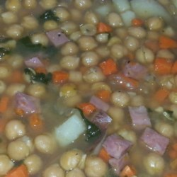 Ham and Chickpea Slow Cooker Soup Recipe - Garbanzo beans, a meaty ham bone, potatoes, carrots, and corn simmer for hours in the slow cooker. It's a hearty, budget-friendly soup supper that takes a long time but doesn't need any attention while it cooks.