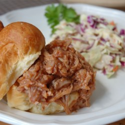 BBQ Pork for Sandwiches Recipe - Mouth-watering pork cooked in a slow cooker with beef broth served with barbecue sauce.