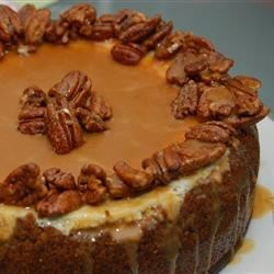 Double Layer Pumpkin Cheesecake with Candied Pecans & Carmel Sauce