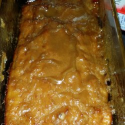 Caramel Ham Loaf Recipe - Ground ham and beef are baked with a brown sugar glaze, making a delicious and easy main dish.  This recipe was a favorite in my catering and restaurant business. Ground ham, ground beef, eggs, bread, brown sugar and mustard.