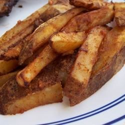Spicy Chili French Fries Recipe - These spicy baked fries are very easy to make, and a great way to kick up your burger platter.