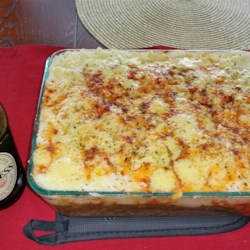 A Scotsman's Shepherd Pie Recipe and Video - This shepherd's pie is made with sharp Cheddar cheese, smoked paprika, stewed tomatoes, and lamb. Use smoked Cheddar, if you have it.