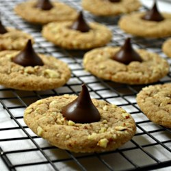 Almond Butter Blossoms Recipe - These little cookies look just like peanut blossoms with the chocolate kiss pressed on, but they're made with almonds instead of peanuts.