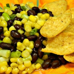 Jennifer's Corn Salad Recipe - Corn salad with black beans, feta cheese, and green onions is a colorful and crowd-pleasing side dish for any meal or party.