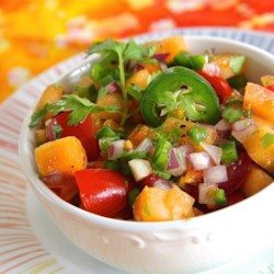 Easy Cantaloupe Salsa Recipe - Cantaloupe salsa made with tomatoes, jalapeno peppers, and cilantro is a sweet and savory version of traditional salsa.