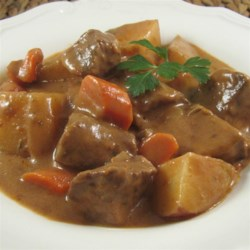 Easy and Hearty Slow Cooker Beef Stew Recipe - A mixture of cream of mushroom soup and tomato sauce is the base for this slow cooker beef stew with potatoes and carrots.