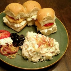 Buffalo Chicken Wing Sliders Recipe - This recipe made slider-size chicken burgers by combining Buffalo wings with a hamburger.
