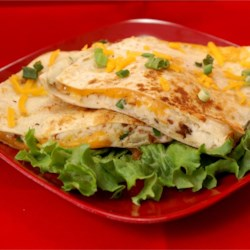 Mashed Potato Quesadilla Recipe - I had something like this at a restaurant last night and I had to try to duplicate it at home! It reminds me of a perogies! I think that this recipe can really be played up with just about anything you like with potatoes! This can be a super fast meal if you use the heat and serve bacon and premade mashed potatoes!