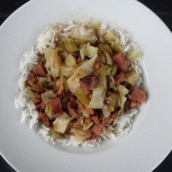Lucky New Year's Black-Eyed Pea Stew Recipe - A savory stew made with 'good luck' black-eyed peas, ham hocks and shredded Napa cabbage gets a kick from cayenne pepper and Cajun seasoning to make a terrific New Year's Day dish.
