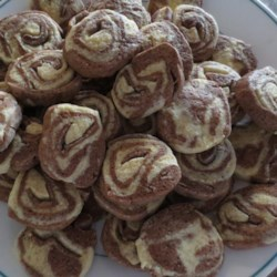Pinwheel Cookies I Recipe - These cookies are mixed, wrapped in wax paper, chilled, sliced and then baked.  My grandmother and my mother both made these and now I make them for my family.