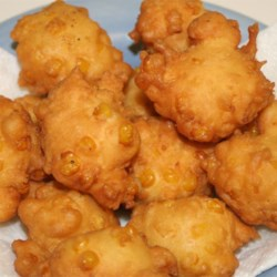 Corn Fritters Recipe and Video - Nothing warms up a cool night like a plateful of old-time corn fritters! Dig in, these are delicious!