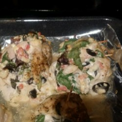 Greek Cream Cheese-Stuffed Chicken Recipe - Cream cheese-stuffed chicken breast with olives, feta cheese, and spinach is a quick and easy Greek-inspired meal.