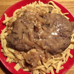 Slow Cooker Autumn Delight Recipe - Cube steaks simmer for hours in a slow cooker in an easy mushroom and onion sauce and served over hot egg noodles for a budget-conscious and comforting main dish.