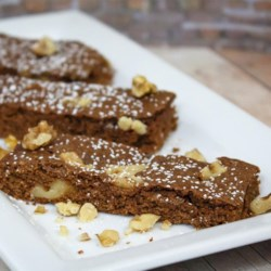 Applesauce Walnut Bars Recipe - These cinnamon-accented bar cookies with chocolate and walnuts are very moist and chewy!