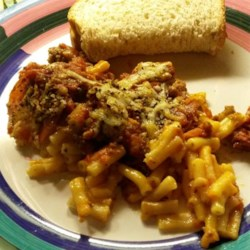 Easy Pizza Macaroni Bake Recipe - Boxed macaroni and cheese is topped with ground beef, pizza sauce, Cheddar cheese, mozzarella cheese, and pepperoni slices in this kid-friendly casserole.