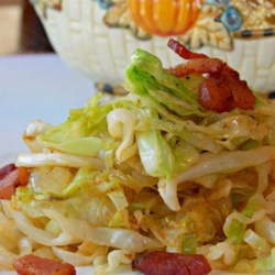 Bonnie's Fried Cabbage Recipe - Fry sliced cabbage with bacon and bacon drippings and butter to produce this scrumptious side dish.