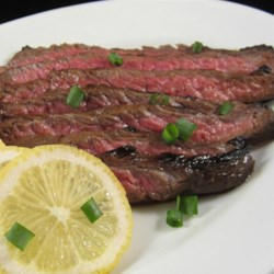 Asian Flat Iron Steak Recipe - Flat iron steak marinated in a soy sauce-based marinade with green onions and garlic is an Asian-inspired dish. Serve with Asian vegetable mix!
