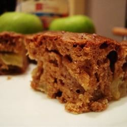 Apple Bars Recipe - This easy snack cake is made with diced tart apples, chopped walnuts, and a hint of cinnamon.