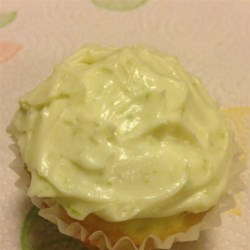 Key Lime Cupcakes Recipe - Key lime cupcakes topped with homemade cream cheese frosting flecked with lime zest are a festive dessert for Cinco de Mayo parties.
