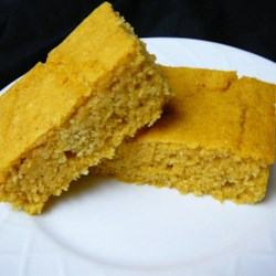 Pumpkin Cornbread Recipe - Cross pumpkin pie with cornbread and you've got pumpkin cornbread, a sweet and savory bread for breakfast or dinner side dish.