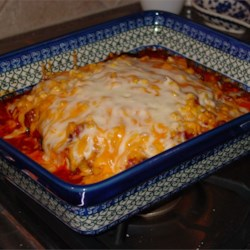 Easy, Cheesy Zucchini Bake Recipe - Perfect for a fast weekday meal, zucchini are baked with spaghetti sauce, ground turkey, corn, and smothered with cheese.