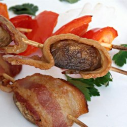 Kansas Quail Recipe - Bacon wrapped-mushrooms are skewered and grilled and will become your most crowd-pleasing snack on the campground.
