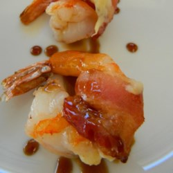 El Dorado Shrimp Recipe - Shrimp are wrapped in cheese and bacon, then topped with a coffee liqueur reduction that is melt-in-your-mouth fantastic.