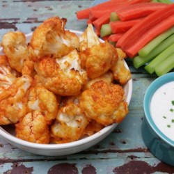 Buffalo Cauliflower Recipe and Video - Buffalo cauliflower is a tasty appetizer of cauliflower coated in a buffalo dip-flavored breading that happens to be gluten-free!