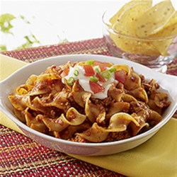NO YOLKS(R) One Pot Cheesy Taco Noodles Recipe - A delicious twist on taco night, this hearty noodle toss can be garnished to taste with your favourite Tex Mex fixings, such as crumbled tortilla chips, sour cream, shredded lettuce, green onion and diced tomatoes.