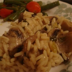 Mushroom Rice Recipe - Rice with mushrooms, garlic, onion - who could beat that? My family loves this recipe! You can also use it as a main meal if you add cooked chicken after the rice is cooked.