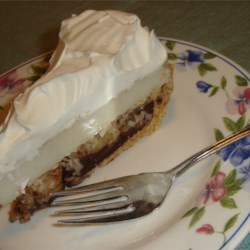 Chocolate Banana Cream Pie Recipe - A creamy layered pie; the layers include chocolate, bananas, and vanilla pudding with coconut. Easy, and very yummy.