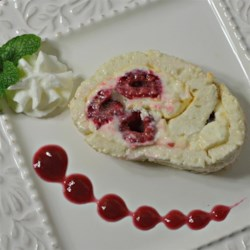 Raspberry and White Chocolate Roll Recipe - A delicious white chocolate cream cheese filling is topped with raspberries and rolled up in a meringue crust to create this easy yet delicious dessert.