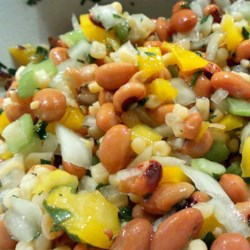 Best Ever Cowboy Caviar Recipe - Cowboy caviar, made with pinto beans, black-eyed peas, corn, and peppers, is fantastic served with tortilla chips.