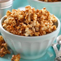 Coconut & Caramel Popcorn Recipe - Fresh popcorn is drizzled with a coconut-caramel sauce for a sweet and crunchy snack.