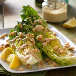Garlicky Grilled Caesar Salad with Cannellini Herb Croutons Recipe - Grilled wedges of romaine lettuce are dressed with a tangy Dijon-lemon dressing and topped with garlic-herb cannellini 'croutons'.