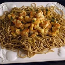 Tropical Shrimp Scampi Recipe - Pineapple juice adds a tropical flair to this yummy, sweet, and garlicky shrimp and pasta dish.
