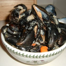 Mussels Moorings Style Recipe - This is a very popular recipe around my house and yields the best mussels in cream and wine sauce that I've ever had. Easy, fun and a wonderful treat.
