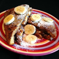 Banana and Nutella(R) French Toast Recipe - French toast is made in a chocolate milk batter and topped with bananas and Nutella(R) for an extra breakfast or dessert treat.