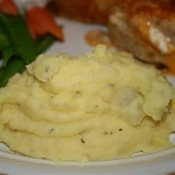 Yummy Yellow Taters Recipe - My two young boys would only eat boxed mashed potatoes, until I came up with this recipe. Little do they (and my finicky husband) know they are also eating their archenemy, onions!! This dish is different because you boil the seasoning with the potatoes instead of adding them later, thus a milder flavor. Serve piping hot with butter or homemade gravy although they don't need either. Enjoy!!!