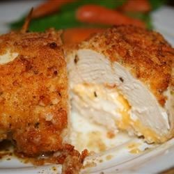 Garlic-Lemon Double Stuffed Chicken Recipe and Video - Chicken breasts stuffed with Cheddar and cream cheeses, then drenched with a garlic-lemon-butter sauce. Sure to become a family favorite.