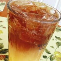 Hilton Head Iced Tea Recipe - Hilton Head iced tea, similar to Long Island iced tea, combines all the clear liquors with orange juice and cola creating a boozy afternoon cocktail for the beach.