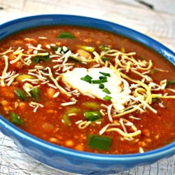 Kickin' Spicy Turkey Beer Chili Recipe - Rich and smoky with Porter beer, jalapenos, and chipotle peppers, this turkey chili's spicy, deep flavors will warm you from your toes up.